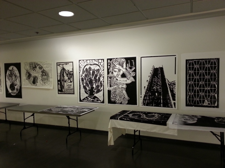 prints displayed on wall at lawrence arts center